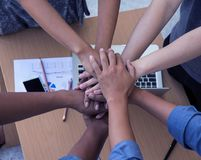 The teamwork hands ,cooperation concept,united hands together with spirit.collaborator and togetherness royalty free stock photography