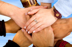 Teamwork - hands together Stock Photo