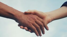 Teamwork handshake concept. Two people shake hands shaking hands. Different skin colours shake hands conclude a business