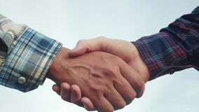 Teamwork handshake concept. Two people shake hands shaking hands. Lifestyle different skin colours shake hands conclude a