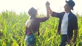Teamwork happy family smart farming concept slow motion video. girl and man shake hands meeting business contract. Agronomist holds digital tablet touch pad stock video footage