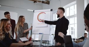 Teamwork at healthy workplace. Smiling middle aged sales coach man leading happy multiethnic workers seminar session. Trendy positive modern office atmosphere stock video