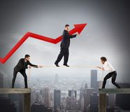 Teamwork help growth. People holding rope to a men balanced stock photo