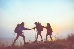 Teamwork hiker women helping her friend climb up Royalty Free Stock Photography