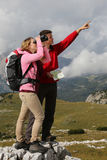 Teamwork while hiking in the mountains Royalty Free Stock Photos