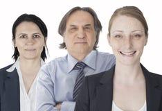 Teamwork im weißen Hintergrund Stockfotografie