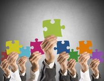 Teamwork and integration concept. Concept of teamwork and integration with businessman holding colorful puzzle Stock Photos
