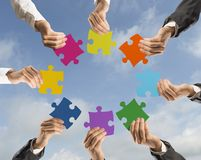 Teamwork and integration concept. Concept of teamwork and integration with businessman holding colorful puzzle Royalty Free Stock Images