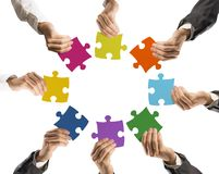 Teamwork and integration concept. Concept of teamwork and integration with businessman holding colorful puzzle Stock Images