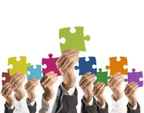Teamwork and integration concept. Concept of teamwork and integration with businessman holding colorful puzzle Royalty Free Stock Photos