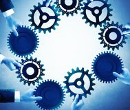 Teamwork and integration concept. With businesspeople that holds gears Stock Image
