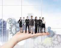 Teamwork and integration concept. Concept of Teamwork and integration with businessperson over the hand Stock Image