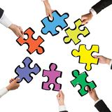 Teamwork and integration concept. With pieces of puzzle Royalty Free Stock Images