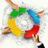 Teamwork and integration concept with puzzle pieces of gear 3D Rendering. Business people join the colorful puzzle pieces of gear. Concept of integration. 3D Royalty Free Stock Photo