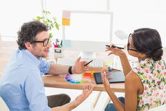 Teamwork interacting together about photos Royalty Free Stock Photo