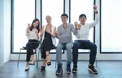Teamwork of international business people taking to each other i. N office Stock Photo