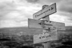 Free Teamwork Is Dreamwork Text Quote On Wooden Signpost Royalty Free Stock Photos - 213000148