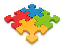 Teamwork jigsaw puzzle concept. Four jigsaw puzzle pieces attached. Concept for teamwork Stock Photos