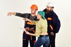 Teamwork is a key to success. Group of constructing engineers and architects at work. Men and woman builders working in. Teamwork is a key to success. Group of stock images