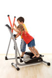 Teamwork - kids playing on elliptical trainer Stock Photos
