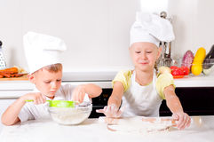 Teamwork in the kitchen Stock Photography