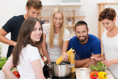 Teamwork in the kitchen stock images