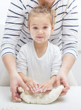Teamwork Kneading Dough Royalty Free Stock Photos