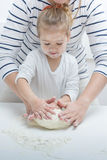 Teamwork Kneading Dough Royalty Free Stock Photo