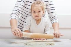 Teamwork Kneading Dough Stock Photo