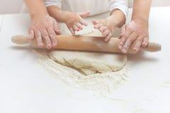Teamwork Kneading Dough Stock Photography