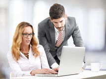 Teamwork with laptop. Executive bussiness women presenting idea to sales man. Teamwork at office Stock Images