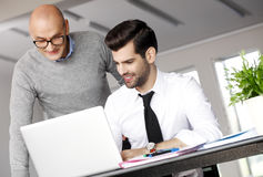 Teamwork with laptop Royalty Free Stock Photography