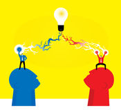 Teamwork : Magic power. Two brains creative power to bright a light bulb Stock Photo