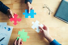 Teamwork meeting Business  Jigsaw Puzzle solution together conce. Pt Stock Photos