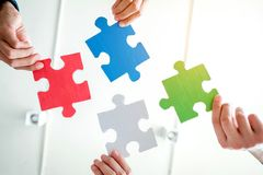Teamwork meeting Business Jigsaw Puzzle solution together concept royalty free stock images