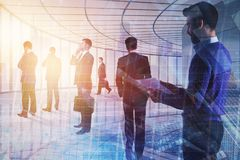Teamwork, meeting and success concept. Businesspeople on abstract office interior with city view and sunlight. Double exposure Stock Photography