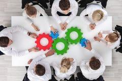 Teamwork mit Zähnen des Geschäfts Stockbilder