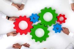 Teamwork mit Zähnen des Geschäfts Stockfoto