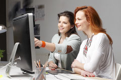 Teamwork at modern graphics studio Stock Photography