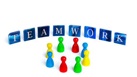 Teamwork. Mosaic tiles with letters and board game pieces - Concept of teamwork Stock Photo