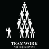 Teamwork is not for everyone. In the workplace isolated on black background Stock Image