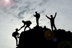 Teamwork och framgång med enhet och samarbete arkivbild