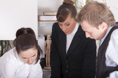 Teamwork in office stock photos
