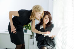 Teamwork in the office Stock Images