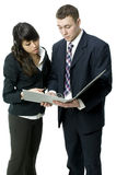 Teamwork in the office. A young business couple sharing ideas over a file Royalty Free Stock Image