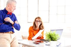 Teamwork in the office. Group of businesspeople working together royalty free stock images