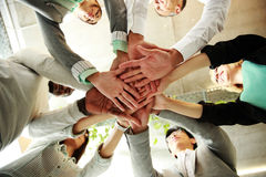 Teamwork in an office with hands together Royalty Free Stock Images