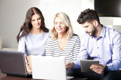Teamwork at office Stock Images