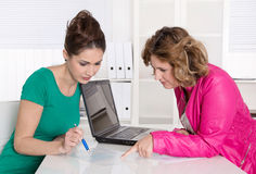 Teamwork at office with two attractive businesswomen. Stock Photo