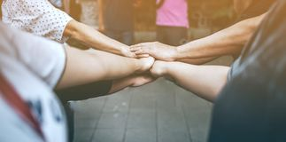 Teamwork With our arms and hands. stock photo
